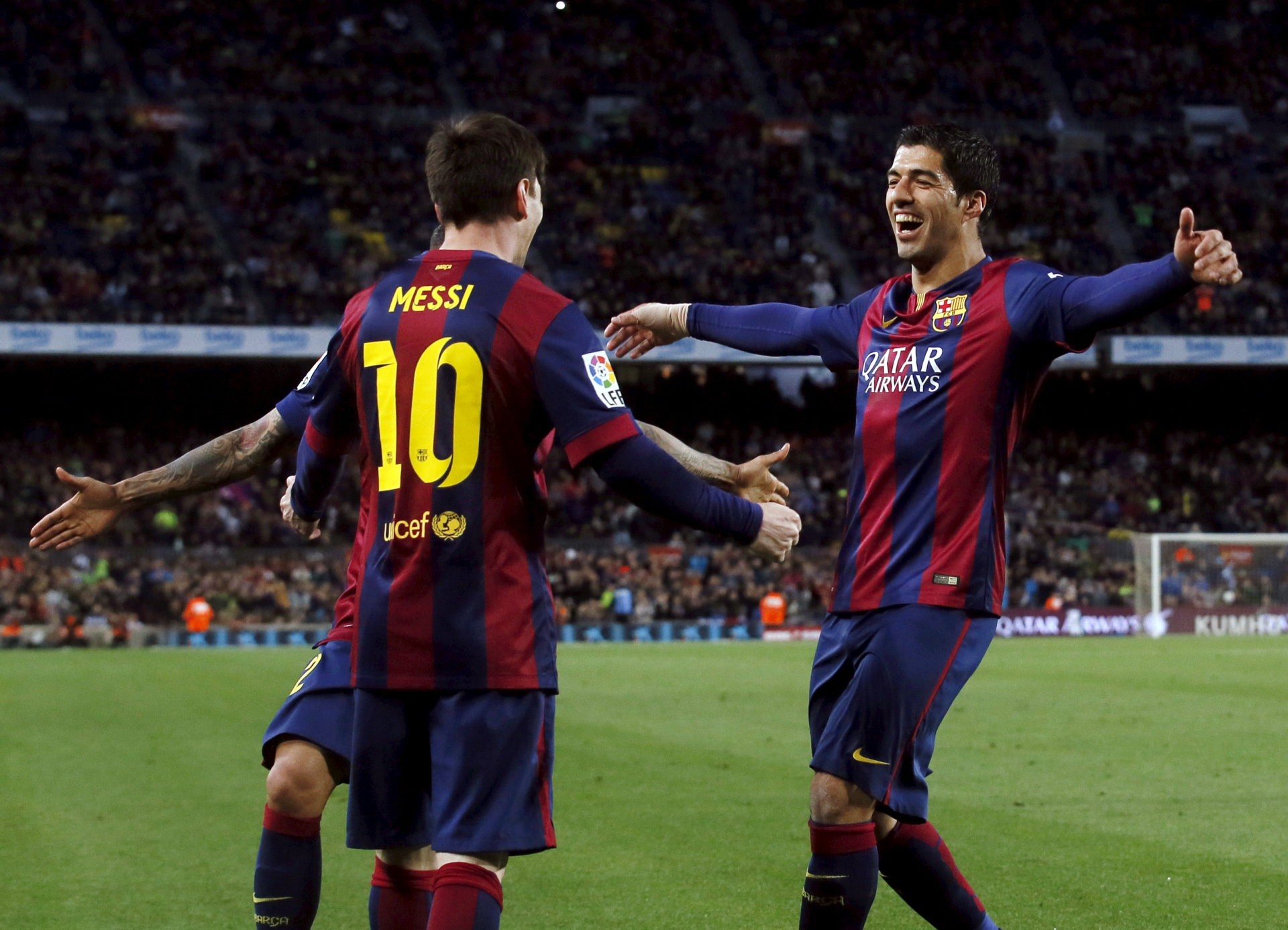 Barcelona's Lionel Messi (L) and Luis Suarez celebrate a goal against Almeria during their Spanish first division soccer match at Camp Nou stadium in Barcelona April 8, 2015. REUTERS/Albert Gea